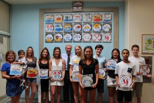 Honorees with Beach Tag Wall
