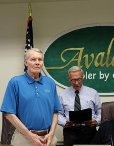 Mayor Pagliughi reads proclamation to Councilman Covington