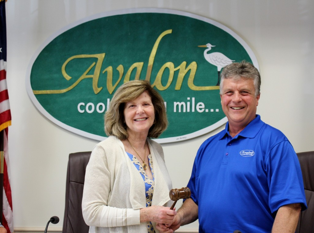 Council President Dr. Nancy Hudanich receives gavel from Councilman Jim Deever